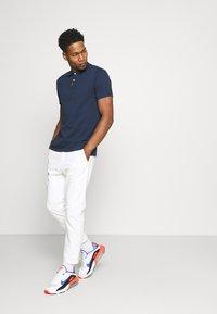 Nike Sportswear - THE SLIM  - Polo shirt - obsidian - 1