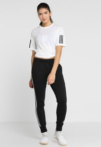 adidas Performance - PANT - Tracksuit bottoms - black/white - 1