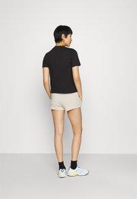 Calvin Klein Jeans - LOGO TRIM - Tracksuit bottoms - white sand - 2