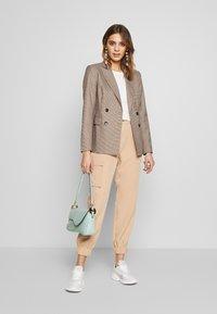 EDITED - SINA TROUSERS - Pantalones - beige - 1