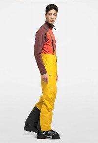 Haglöfs - LUMI LOOSE PANT - Snow pants - pumpkin yellow - 1