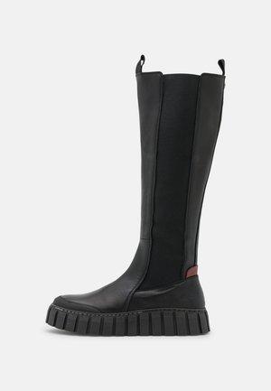SUNDARI - Platform boots - black