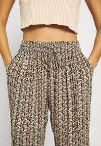Kaffe - ROKA AMBER PANTS - Trousers - grape leaf - 6