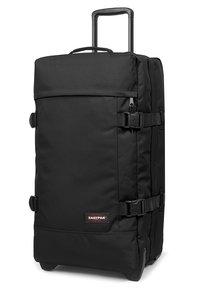 Eastpak - TRANVERZ M CORE COLORS - Wheeled suitcase - black - 4