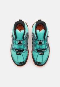 adidas Performance - TERREX MID GTX UNISEX - Hiking shoes - acid mint/core black/screaming orange - 3