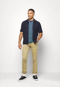 Levi's® - 511™ SLIM - Jeans slim fit - harvest gold - 1