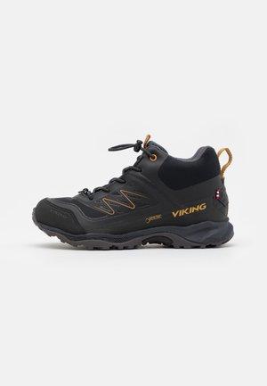 TIND MID GTX UNISEX - Hiking shoes - black