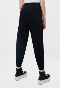 Bershka - Teplákové kalhoty - black - 2