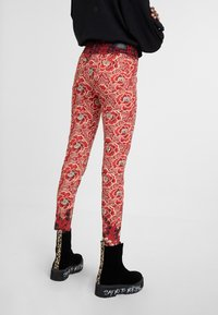 Desigual - DESIGNED BY M. CHRISTIAN LACROIX - Bukser - red - 2