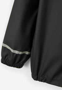 Name it - NKNDRY RAIN SET UNISEX - Rain trousers - black - 4