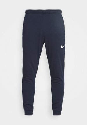 PANT TAPER - Tracksuit bottoms - obsidian/white