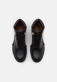 Coach - LORIMER BOOTIE - Lace-up ankle boots - black - 4