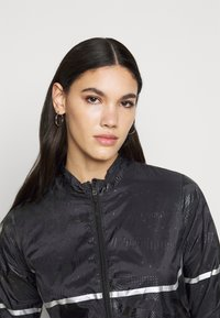 ONLY PLAY Tall - ONPONAY TRAINING JACKET  - Summer jacket - black - 3
