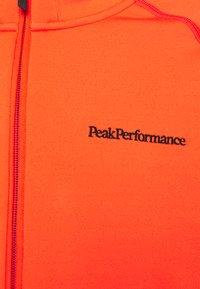 Peak Performance - CHILL ZIP HOOD - Fleecejacka - super nova - 2