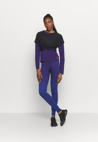 Reebok - SEASONAL SEAMLESS - Leggings - purple - 1