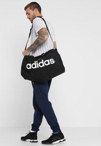 adidas Performance - LIN CORE  - Sports bag - black/white - 5