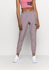 Nike Performance - RUN PANT - Joggebukse - purple smoke/light violet/black - 0
