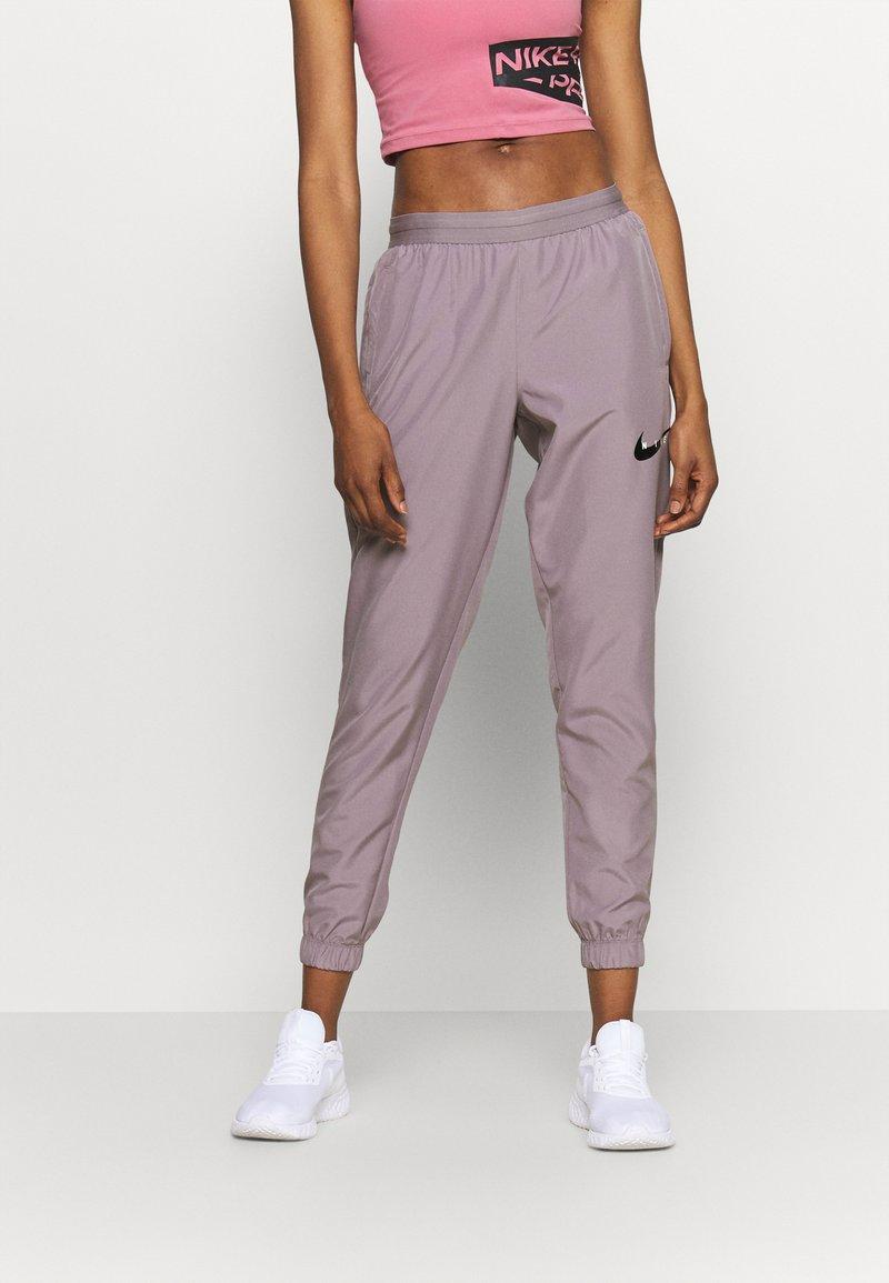 Nike Performance - RUN PANT - Joggebukse - purple smoke/light violet/black