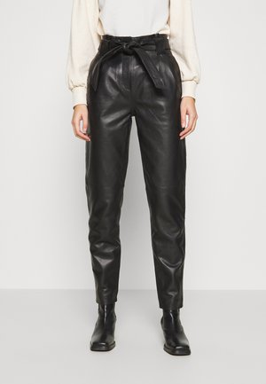 NAGO TROUSERS - Leather trousers - black