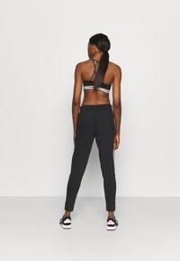adidas Performance - COLORBLOCK ESSENTIALS - Teplákové kalhoty - black/white - 2