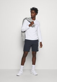 Champion - LEGACY BERMUDA - Sports shorts - dark blue - 1