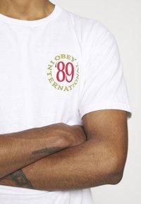 Obey Clothing - INTERNATIONAL - T-shirts print - white - 4