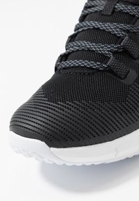 Under Armour - HOVR RISE - Sports shoes - black/white - 5