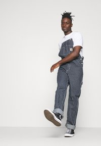 Carhartt WIP - TRADE OVERALL - Jeans Relaxed Fit - dark navy/wax rinsed - 4