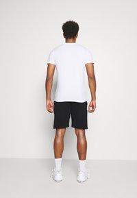 Tommy Hilfiger - SHORT - Sports shorts - black - 2