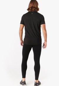 Smartwool - T-shirt basic - black - 1