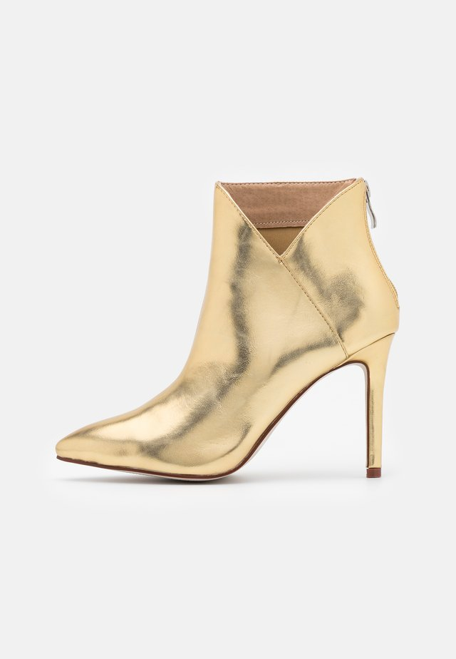 DIANNE - High heeled ankle boots - gold