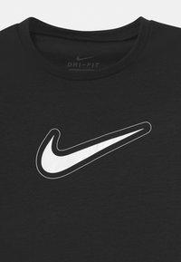 Nike Performance - DRY TROPHY  - Print T-shirt - black/white - 2