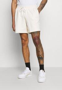 adidas Originals - PREMIUM UNISEX UNISEX - Tracksuit bottoms - offwhite - 0