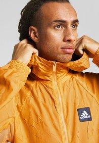adidas Performance - Sportovní bunda - real gold - 4