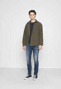 Nudie Jeans - LEAN DEAN - Slim fit jeans - born blue - 1