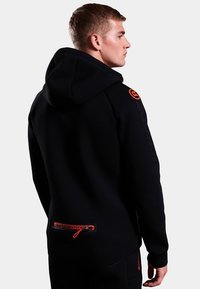 Superdry - GYM TECH STRETCH  - Training jacket - black - 2