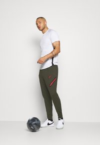 Nike Performance - PORTUGAL DRY PANT  - Träningsbyxor - sequoia/sport red - 1