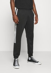 adidas Originals - CLASSICS  - Jogginghose - black/white - 0