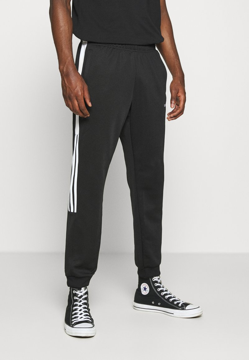 adidas Originals - CLASSICS  - Jogginghose - black/white