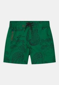Mini Rodini - TIGERS - Swimming shorts - green - 0