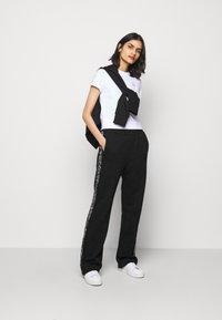 HUGO - NENNIFER - Pantalones deportivos - black - 1