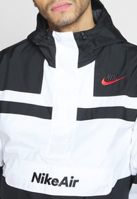Nike Sportswear - M NSW NIKE AIR JKT WVN - Wiatrówka - white/black - 5