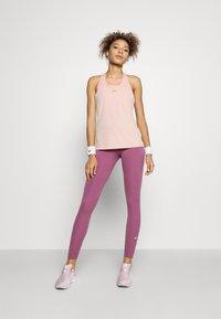Nike Performance - FEMME ELASTIKA TANK - Toppe - pink oxford/metallic gold - 1