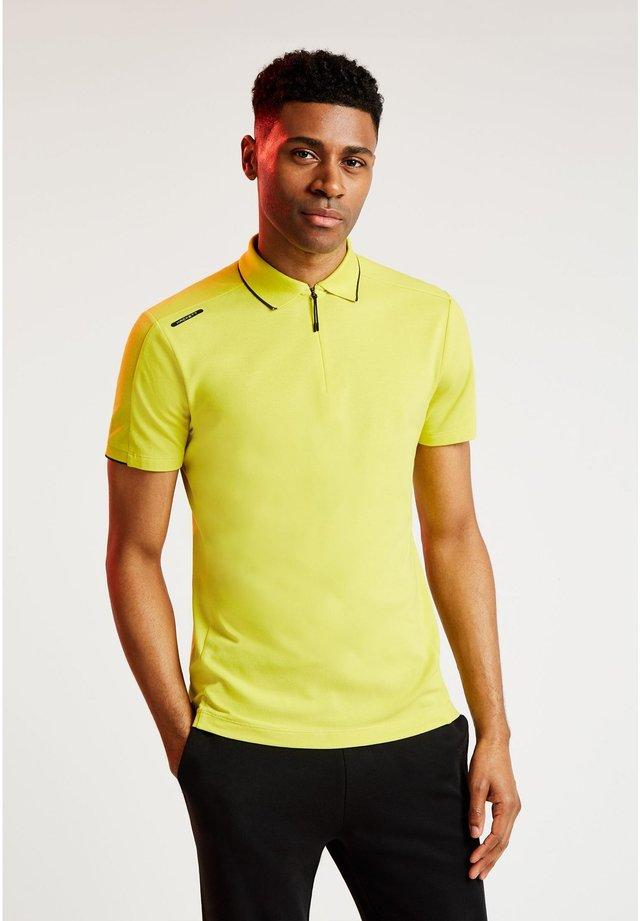 AMR PRO - Polo shirt - millennium ylw