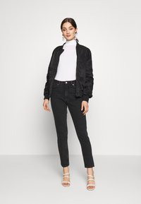 Monki - KIMOMO - Jeans straight leg - black - 1