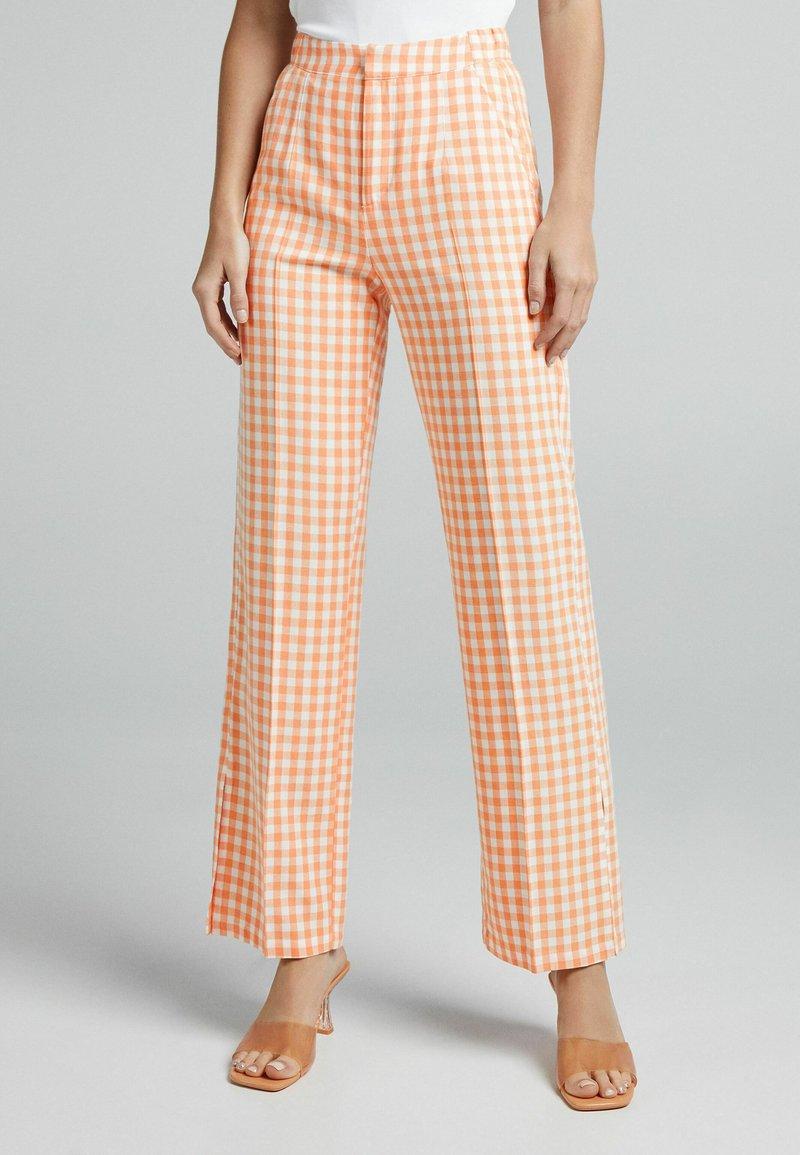 Bershka - Trousers - orange