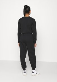 Topshop - JOGGER WITH GRAPHIC - Tracksuit bottoms - black - 2
