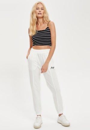 Pantalones deportivos - ecru