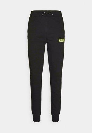 CORE JOGGERS - Pantalones deportivos - black/lime
