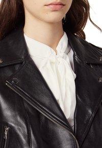 sandro - SIOUXIE - Leather jacket - noir - 4